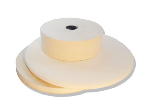 Stack of white felt contact wheels for Bader grinders and polishers