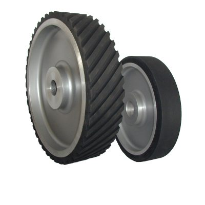 "Large rubber contact wheels, serrated and plain from 2"" - 18"" OD, 1/4' to 6"" wide"